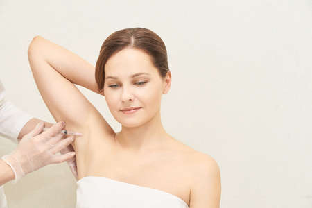 Armpit cosmetology injection. Sweat treatment in cosmetic clinic. Woman skin care procedure. Doctor hand. Reklamní fotografie