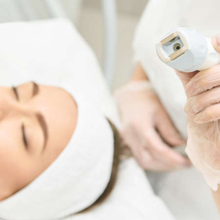 Vacuum face cosmetology equipment. Facial salon cleaning. Youn girl professional skin care. Beauty woman and health device. Reklamní fotografie