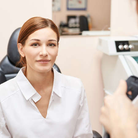 Eye ophthalmologist exam. Eyesight recovery. Astigmatism check concept. Ophthalmology diagmostic device. Beauty girl portrait in clinic. Banco de Imagens