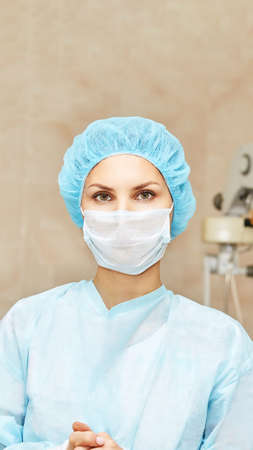 Pretty doctor woman portrait. Ophthalmology laser microscope operation. Clinic room. Patient eye treatment. Myopia and cataract removal.