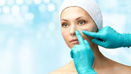 Female derma rejuvenate treatment. Doctor in gloves touch woman face. Cosmetology pretty portrait. Facial nosr injection patient.