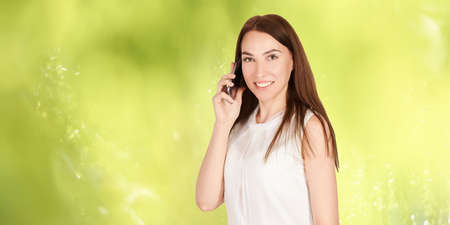 Young girl with mobilephone. Business woman talking on phone. Adorable caucasian businesswoman shopping.