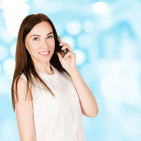 Young girl with mobilephone. Business woman talking on phone. Adorable caucasian businesswoman shopping. Zdjęcie Seryjne - 131841520