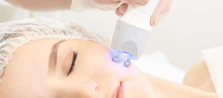 Dermatology skin care facial therapy. Medical spa anto wrinkles procedure. Woman face rejuvenation. Pretty girl. Rf cosmetician equipment.