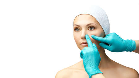 Female derma rejuvenate treatment. Doctor in gloves touch woman face. Cosmetology pretty portrait. Facial nosr injection patient. Zdjęcie Seryjne - 131841629