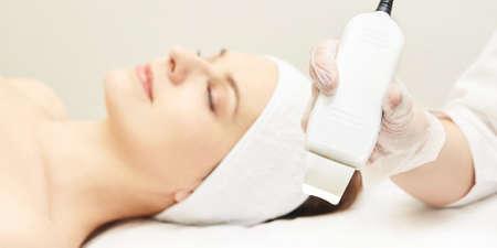 Ultrasonic skin equipment. Woman face cosmetology treatment. Girl clinic facial procedure. Anti acne surgery cleaning. Stock fotó