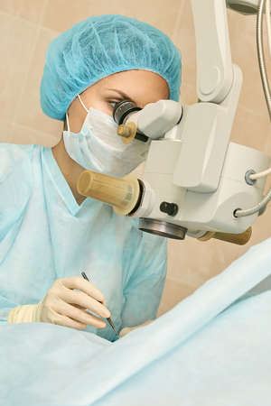 Ophthalmology laser microscope operation. Doctor in clinic. Patient eye treatment. Myopia and cataract removal. Stock Photo