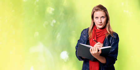 Young girl with notebook. Business woman write. Adorable caucasian businesswoman. Stock Photo