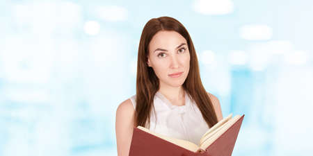 Young girl with notebook. Business woman write. Adorable caucasian businesswoman. Zdjęcie Seryjne - 131842298