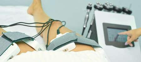 Laser lipo equipment. Cosmetic fat reduce treatment. Woman in medicine salon. Anti cellulite procedure.