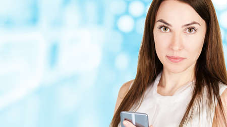 Young girl with mobilephone. Business woman write on screen. Adorable caucasian businesswoman texting to friend.