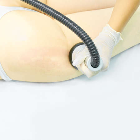 Vacuum massage device. Anti cellulite body correction treatment. Loss weight apparatus. Woman and doctor at medicine salon.