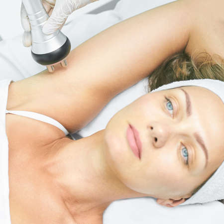 Perfect body radio treatment. Woman at spa procedure. Doctor hand and girl body. RF cosmetology lifting. Flabby hand.