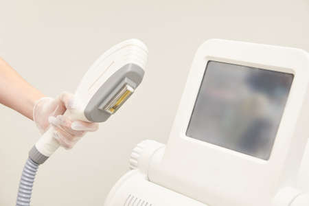 Laser elos medical device. Remove unwanted hair and asteriks. Cosmetology spa procedure at salon. Depilation equipment.