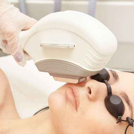 Laser elos medical device. Remove unwanted hair and asteriks. Cosmetology spa procedure at salon. Chin facial depilation.
