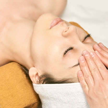 facial woman massage. Hot face masseur. Girl at salon with doctor hands. anti age.