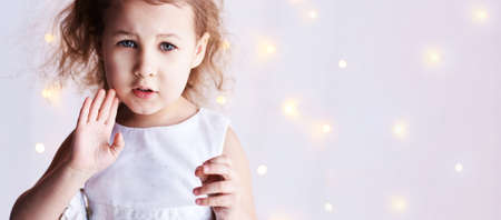 Stop denied gesture. Little cute girl sale portrait. Photography of luxury female child. Sad emotion. Fresh person face. Kid eyes. Look at camera. Stock Photo