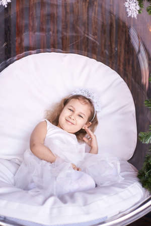 Happy amazed female kid emotion. Dreaming child studio portrait. Young girl imagine sweet dreams. Little woman exited joy.