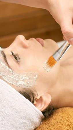 chemic facial peel mask. Cosmetology acne treatment. Young girl at medical spa salon. Brush. Face fruit acid. Sensitive peeling.