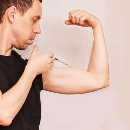 Man inject steroid hormone. Copy space. biceps bodybuilder muscle doping. Growth injection procedure. Male person shot. Insulin drug procedure. Copyspace square banner