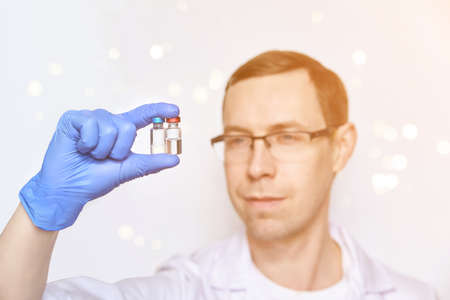Doctor hand holf medicine vaccine. Anti virus health treatment. Medical nurse surgical. Pharmacy laboratory. Reseach center. Covid concept. Safety anaesthetist procedure. White background. Man face