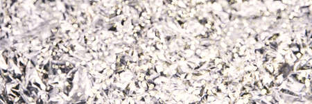 Foil aluminum crushed texture. Metal material background. Silver grunge decoration. Material pattern. Crinkle chrome paper. Fabric shine sheet. Grey color. Horizontal banner. Copyspace for text