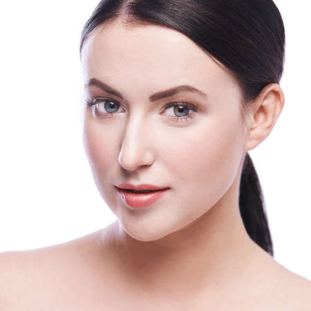 Woman beauty portrait. Pretty girl cosmetology face. Skin care home routine. Girl look at camera. White isolated background. Healthcare laser treatment. Detox diet. Facial lifting.