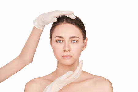 Beauty girl cosmetology test. Doctor gloves. Cosmetology clinic treatment. Woman face therapy. Plastic opeartion prepare. Facial procedure. White isolated background Standard-Bild