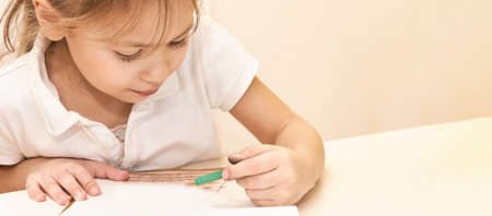 Young child write at notebook. Pencil draw stars. Close up. Education painting. kindergarten draw exercise. Preschool picture. Horizontal banner with copyspace Foto de archivo