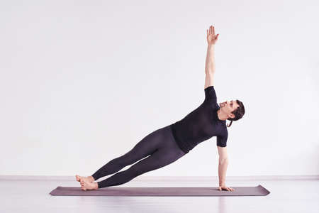 Man practice yoga. Pilates training at home. Dancer workout. Online teacher. Balance asana Foto de archivo - 152515328