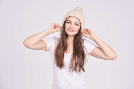 Beauty girl in light hat. Woman Model pretty face. Hipster perfect portrait at studio