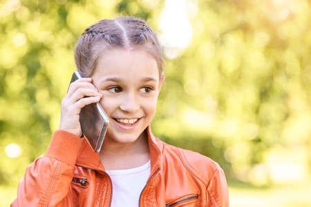 Cute little girl talking. Hold phone near face.