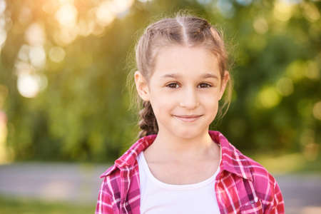 Funny young girl at park. Finish lockdown. Smile spanish person. Schoolgirl portrait. Summer female portrait. Face. Attractive lifestyle. Pretty kid. Looking at camera Foto de archivo