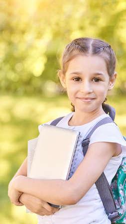 Young schoolgirl with backpack. Happy preschool kid. Back to school Foto de archivo