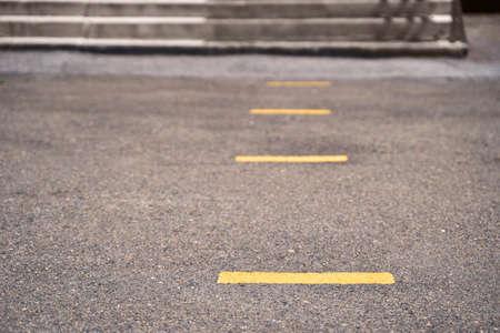Social distance concept. Keep near yellow line.