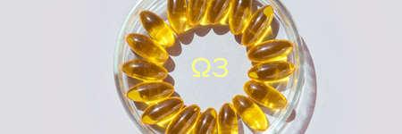 Omega3 gel capsule. Yellow vitamin. Health eating.