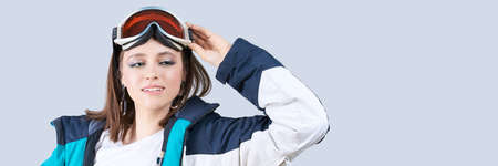 Beauty sport girl. Snowboard jacket. Pretty young woman in fitness clothes. Foto de archivo
