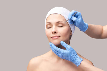 Beautician skin care. Face tweezers. Facial treatment. Woman dermatology. Salon routine. Applying mascara with device. Doctor procedure. Eyebrow countour tint. Beauty hair concept.