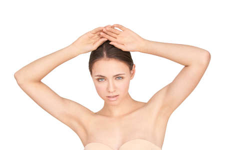 Girl armpit. Clean skin. Hands up. Deodorant skincare. Without hair under arms. Pretty girl studio portrait. White isolated background. Depilation concept. Home routine Foto de archivo