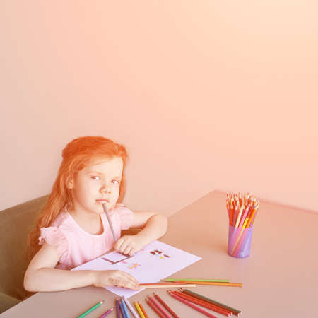 Little girl drawing. Closed Locking Exercise. Homemade routine. School lessons. Write pencil on piece of paper. Kindergarten study. Elementary preschool. Woman kid student. Thinking or dreaming