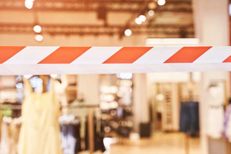 Nobody at shop. New normal. Lockdown mall. Restaurant quarantine. Hazard infection trouble. Red and white barricade tape. Close area. Corona risk hotel. Shutdown economy. Copyspace.