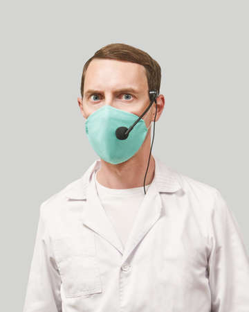 Male doctor with headphones. Studio Medicine portrait. Clinic online help. Health support call. Telemarketing agent microphone. Multi language translator. Telemedicine equipment. Angry emotion