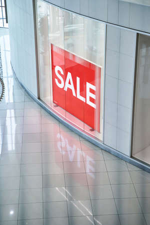 Sale red sign at the retail shop