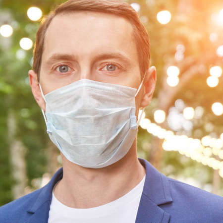 Man in protective face mask at city. Male person portrait. Lockdown concept. Sick communication. Allergy safety. Local travel. Respiratory prevention flu. Anti virus