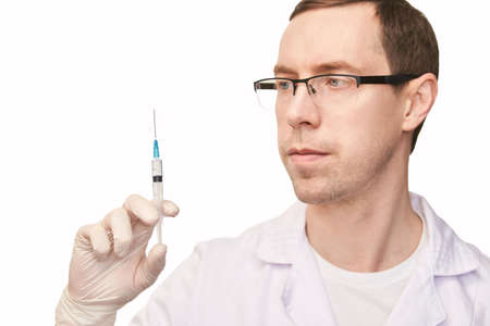 Male person in white glove hold vaccine bottle with syringe. Injection pharmacy concept. Medical nurse therapy. People hand health science. Horizontal banner. Man face