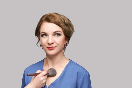 Woman do makeup. Face cosmetic brush. Skin care. Facial hightlighter. Mascara foundation. Skincare cover. Female facial powder