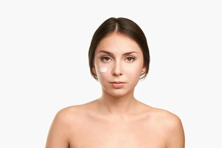 Young woman. Skincare cream. Sunscreen product. Beauty female person on vacation
