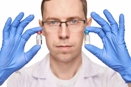 Male person in blue glove hold vaccine bottles. Injection drug pharmacy concept. Medical nurse therapy. People hand health science. Square banner. Man face