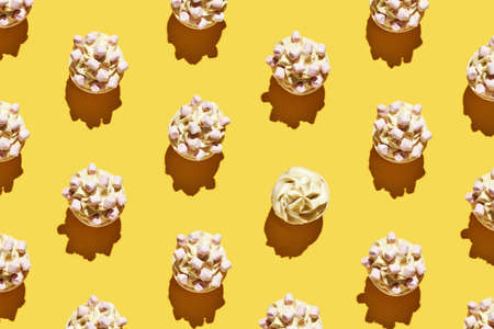 Milky cream cupcake. Birthday sweet bakery. Cookies. Yummy buttercream dessert. Wedding party food. Yellow background. 版權商用圖片