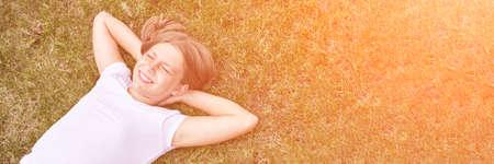 Little girl portrait. Outdoor green background. Closed eyes. Teenager schoolgirl at park. Cute face. Children beauty. Female head. Charisma caucasian